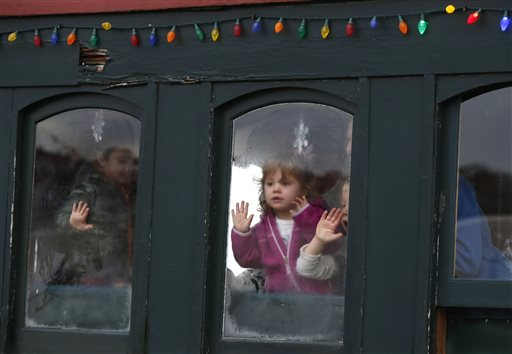 Children keep an eye out for Santa Claus as the Polar Express begins its journey to the 'North Pole' on the Maine Narrow Gauge Railroad.