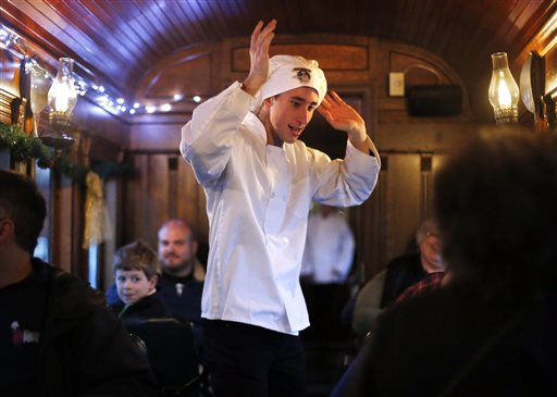 Alex Cotrell plays the role of the dancing chef after delivering hot chocolate to passengers on board the Polar Express on the Maine Narrow Gauge Railroad.