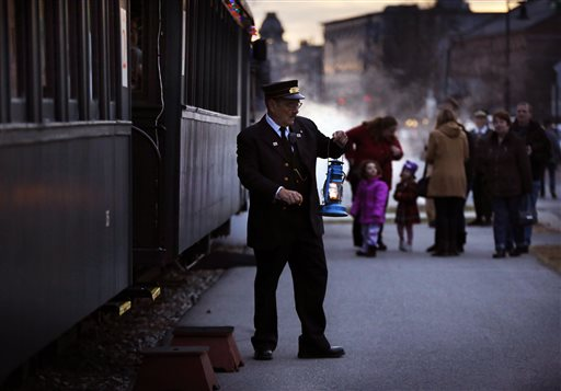 Conductor Brian Durham prepares to board the Maine Narrow Gauge Railroad's Polar Express train.