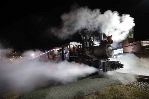 Steams shoots out from a 1913 steam locomotive as the Polar Express begins it's journey to the 'North Pole' on the Maine Narrow Gauge Railroad.