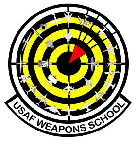 "The current U.S. Air Force Weapons School's patch design, adopted in 2012, reflects the expansion of the school, with 26 aircraft and weapons systems encircling a red ""bomb on target"" over a black and yellow bullseye background."" 