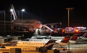 Emergency vehicles are parked near an Air France plane that was diverted to Salt Lake City International Airport, Tuesday, Nov. 17, 2015, in Salt Lake City. Officials said two Air France flights bound for Paris from the U.S. had to be diverted because of anonymous threats issued after they took off, but both planes landed safely. (Ravell Call/The Deseret News via AP) SALT LAKE TRIBUNE OUT; MAGS OUT; MANDATORY CREDIT; TV OUT