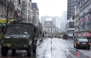 Belgian military vehicles are parked on a main avenue in Brussels on Saturday, Nov. 21, 2015. Belgium raised its security level to its highest degree on Saturday as the manhunt continues for extremist Salah Abdeslam who took part in the Paris attacks. The security levels shut down all metro lines and shuttered many shops as well as canceling sports matches, Brussels, Belgium, Nov. 21, 2015 | AP Photo by Virginia Mayo, St. George News