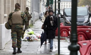 Belgian Army soldiers patrol next to flowers left outside of the French Consulates office in Brussels Saturday, Nov. 21, 2015. Belgium raised it security level to it's highest degree on Saturday as the manhunt continues for extremist Salah Abdeslam who took part in the Paris attacks, Belgium, Nov. 21, 2015 | AP Photo by Virginia Mayo, St. George News