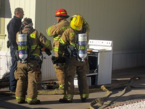 Firefighters remove an oven and burned turkey from a residence on Dixie Downs Road, St. George, Utah, Nov. 26, 2015 | Photo by Ric Wayman, St. George News