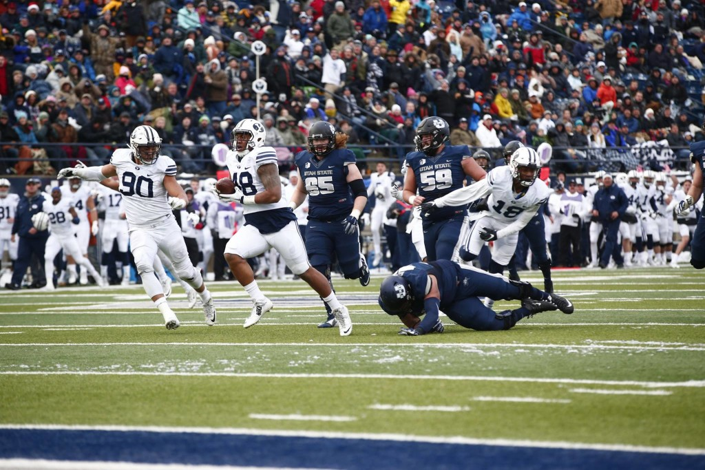 BYU lineman Tomasi Lauile (48) scores a defensive touchdown for the Cougars, BYU at Utah State, Logan, Utah, Nov. 28, 2015   Photo courtesy BYU Photo
