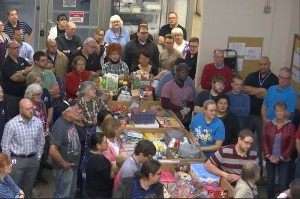 RAM Company employees gather around boxes of food they gathered and donated to the Utah Food Bank, St. George, Utah, Nov. 18, 2015 | Photo by Sheldon Demke, St. George News