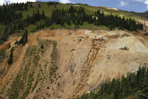Environmental Protection Agency contractors use heavy machinery to repair damage at the site of the blowout at the Gold King mine which triggered a major spill of toxic wastewater, outside Silverton, Colorado, Aug. 12, 2015   AP Photo by Brennan Linsley, St. George News