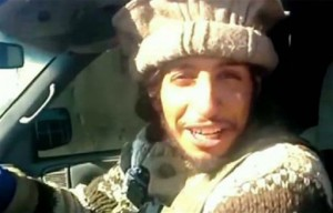 This undated image taken from a Militant Website on Monday Nov. 16, 2015 showing Belgian Abdelhamid Abaaoud. A French official says Abdelhamid Abaaoud is the suspected mastermind of the Paris attacks was also linked to thwarted train and church attacks, location and date unknown   Militant video via AP, St. George News