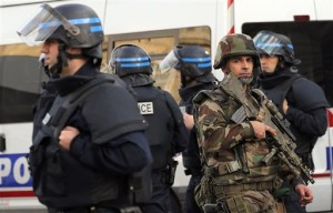 Police forces and soldiers patrol in Saint-Denis, a northern suburb of Paris. Police say two suspects in last week's Paris attacks, a man and a woman, have been killed in a police operation north of the capital. Two police officers have been injured in the standoff. Police have said the operation is targeting the suspected mastermind of last week's attacks, believed to be holed up in an apartment in Saint-Denis with several other heavily armed suspects, Saint-Denis, France, Nov. 18, 2015 | Photo by Christophe Ena (AP), St. George News