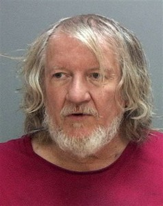 The booking photo of Michael Salata, 61, who is accused of stealing an airline boarding pass in Salt Lake City and checking into a flight to California before he was caught on Nov. 5. Salt Lake City, Utah, Nov. 6, 2015 | Photo courtesy of Salt Lake County Jail (AP), St. George News