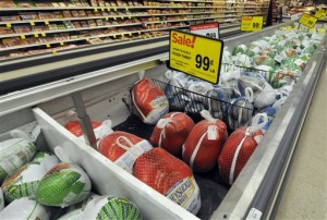 In this Nov. 5, 2015, photo, Thanksgiving turkeys are shown at a Cub Foods store in Bloomington, Minn. Richard Volpe, a retail food price economist formerly with the U.S. Department of Agriculture, said one of the most effective things supermarkets can do to lure holiday shoppers is to advertise cheap turkeys whose prices tend to be lowest around the holidays when demand is highest. Bloomington, Minnesota, November 5, 2015 | AP Photo by Jim Mone, St. George News