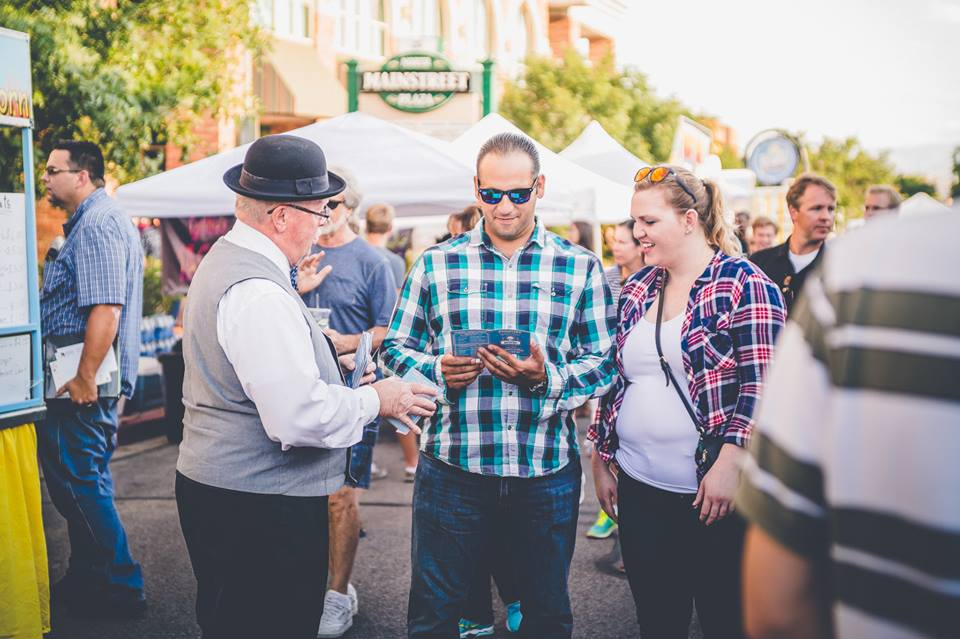 Uncle George hands out passports at a First Friday event, St. George, Utah, date unspecified | Photo courtesy of Emceesquare Media & Events, St. George News