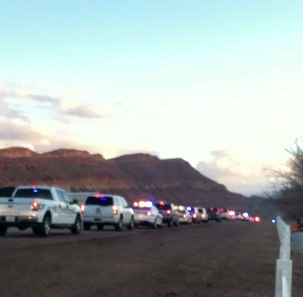 """A procession of law enforcement vehicles, lights on sirens blaring, head out from Washington County Regional Park, with kids in ride-along for the annual """"Shop with a Cop"""" spree across Washington County. Hurricane, Utah, Dec. 12, 2015 