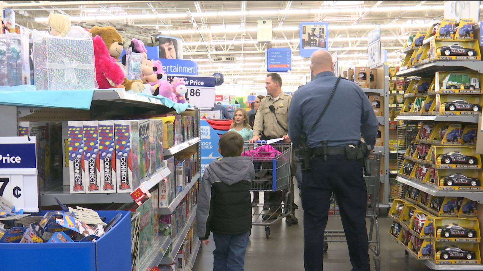 Kids and police officers shop at the annual Shop with a Cop event, Washington, Utah, Dec. 12, 2015 | Photo by Sheldon Demke, St. George News