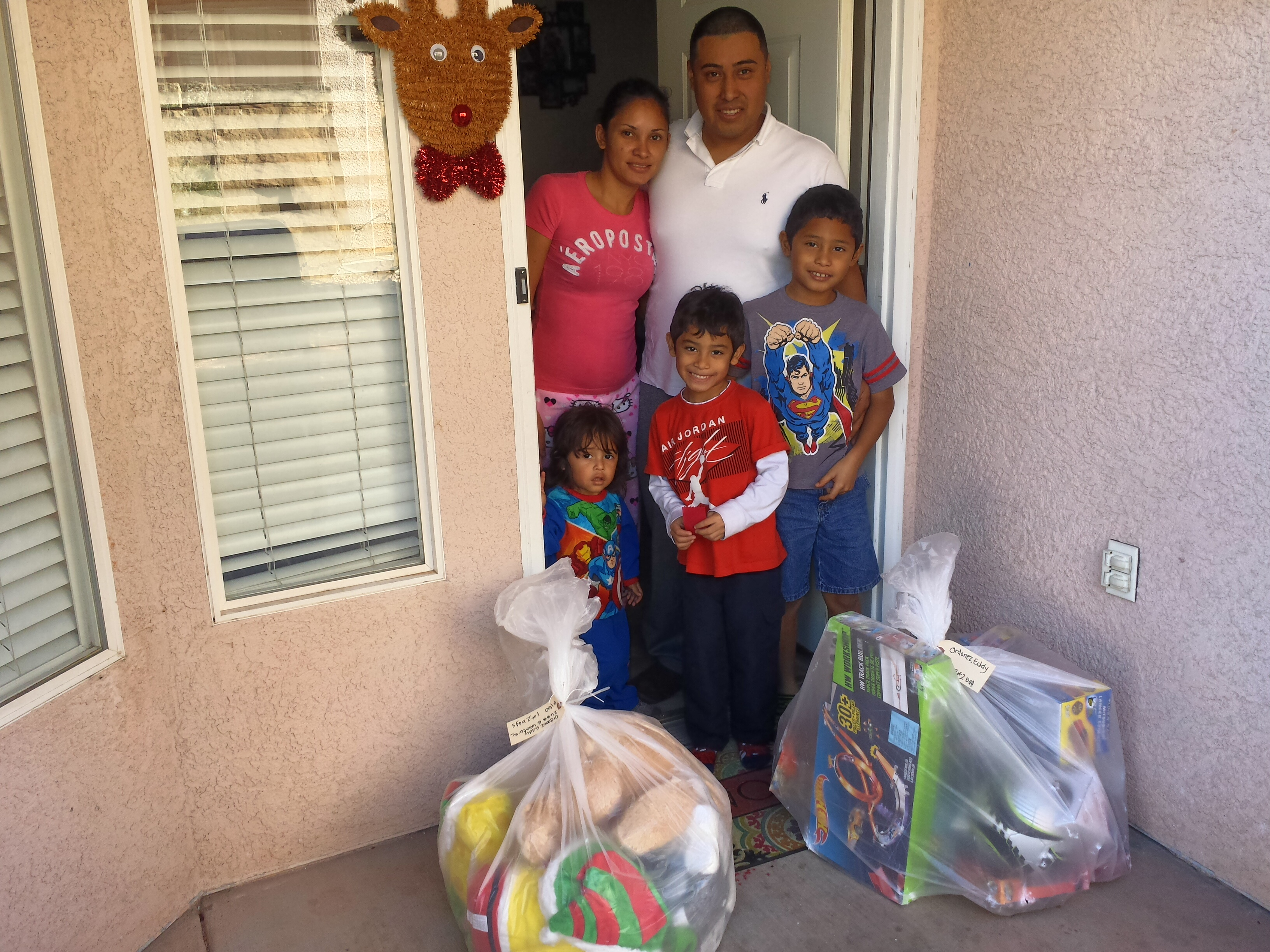 This family received a delivery of Christmas toys from Toys for Tots, St. George, Utah, Dec. 19, 2015 | Photo courtesy of Shane Dastrup, St. George News