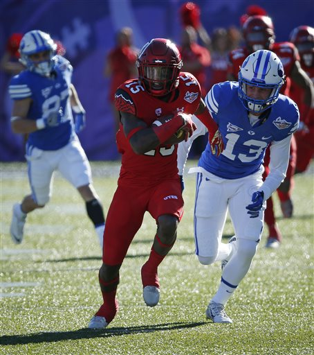 Utah defensive back Dominique Hatfield runs after making an interception against BYU during the first half of the Las Vegas Bowl NCAA college football game Saturday, Dec. 19, 2015, in Las Vegas. (AP Photo/John Locher)