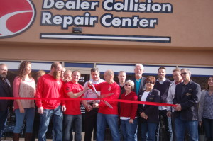 Employees of the Dealer Collision Repair Center and St. George Mayor Jon Pike join members of the St. George Chamber of Commerce as well as the Dixie Sunshiners in a ribbon cutting ceremony celebrating the opening of the new Dealer Collision facility, St. George, Utah, Dec. 4, 2015 | Photo by Hollie Reina, St. George News