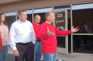 Mayor Pike (L) and Dealer Collision Repair Center General Manager Jesse Thompson (R) stand at the entrance to the office of the new Dealer Collision Location, St. George, Utah, Dec. 4, 2015 | Photo by Hollie Reina, St. George News