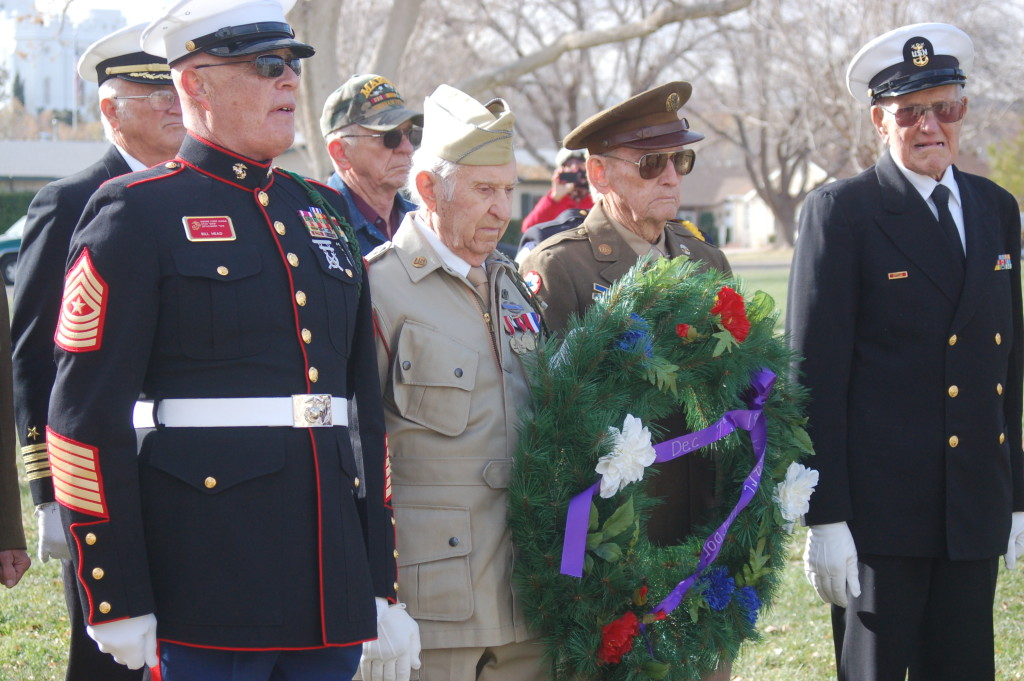 In this photo from 2015, a wreath honoring the lives lost at Pearl Harbor is placed in front of a memorial located at Vernon Worthen Park, St. George, Utah, Dec. 7, 2015 | Photo by Hollie Reina, St. George News