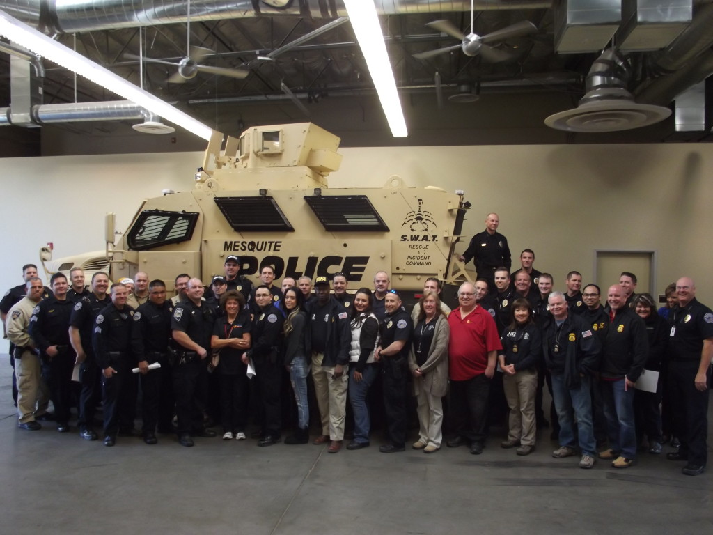 """In this 2015 file photo, Mesquite police officers and other participants gather for the """"Shop with a Cop"""" event, Mesquite, Nevada, December 2015 