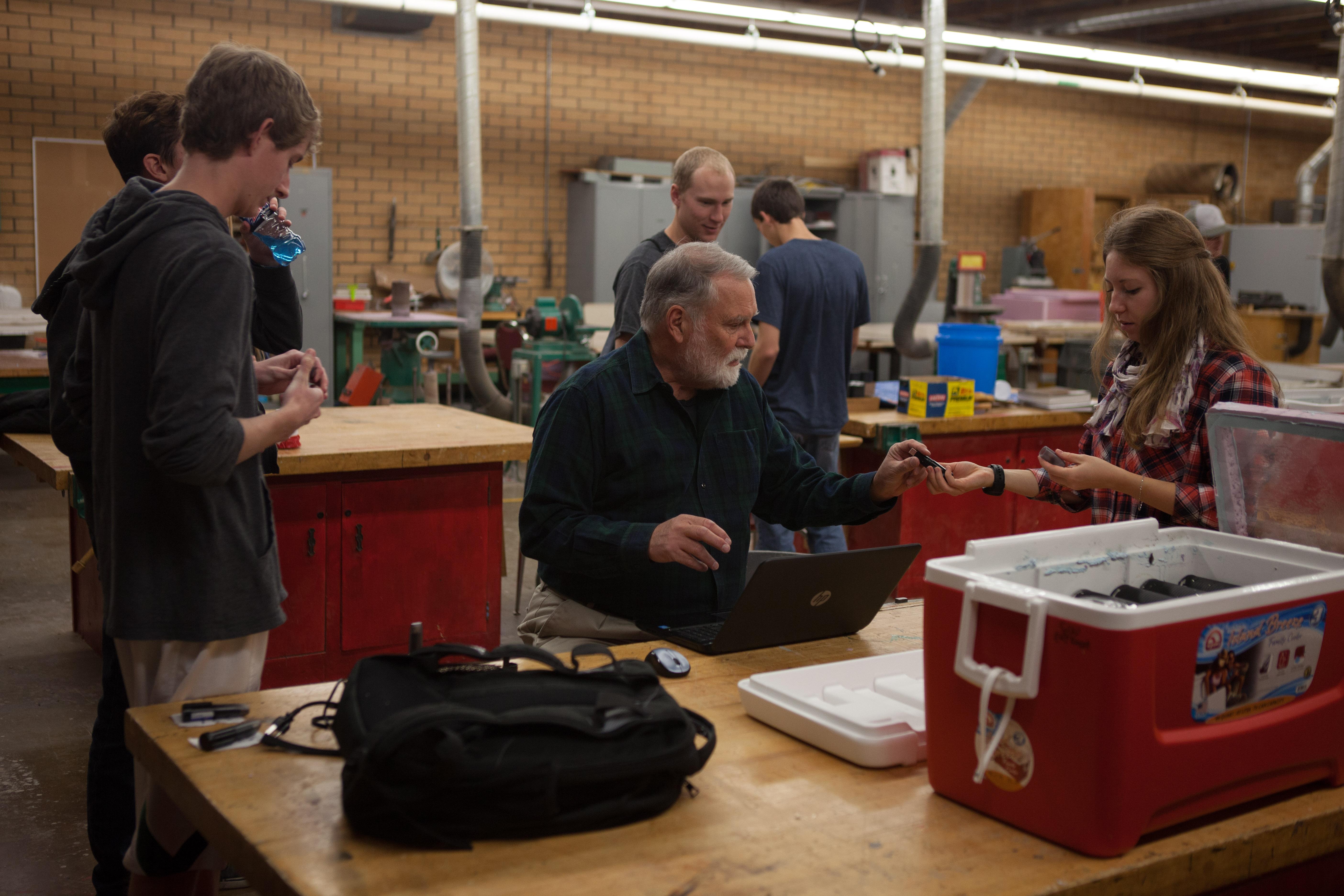 John Murray with solar students