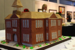 """This photo shows a cake baked to replicate the Woodward School in St. George. According to the Washington County Historical Society, the Woodward School was constructed between 1898 and 1901, when its doors opened. It was named after George Woodward, a childless resident, who had served as chairman of the school board during the construction. """"The school was a real change from the previous schools,"""" the society's Web page regarding the school states. """"There was a lot more space, the classrooms had blackboards on three walls, they had radiator heat rather than pot-bellied stoves that were either too hot or too cold …."""" The cake was offered at a reception honoring Washington County School Disrict's centennial. Eccles Fine Arts Center, Dixie State University campus, St. George, Utah, Dec. 7, 2015 