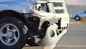 Front end damage on a 2004 Ford Explorer pickup that collided with the center guardrail on Dec. 26, 2015 | Photo by Don Gilman, St. George News