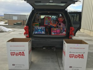 Enoch Police Sgt. Mike Berg and his family were some of the volunteers that loaded up their vehicles with Toys for Tots for Christmas. Enoch, Utah, Dec. 23, 2015 | Photo by Tracie Sullivan, St. George News