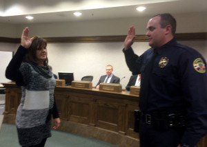 Cedar City Recorder Renon Savage officiates the swearing in of Bryan Moore as part of the Cedar City Police Department, Council Chambers, Cedar City, Utah, Dec. 17, 2015 | Photo by Carin Miller St. George News