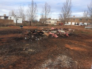 The debris left at the end of cleanup day lies where their house once stood, The Barlow's property, Centennial Park, Ariz., Dec. 19, 2015 | Courtesy of Jennifer Barlow, St. George News
