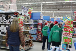 Church groups, social groups, and family groups shop for needy children at Bloomington Wal-Mart for KONY Coins for Kids, St. George, Utah, Ded. 16, 2015|Photo by Cody Blowers