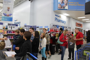 Volunteers flood into Bloomington Wal-Mart to shop for needy family through KONY Coins for Kids, St. George, Utah, Dec. 16, 2015| Photo by Cody Blowers