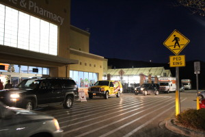 3 UHaul trucks parked in front of Bloomington Wal-Mart for KONY Coins for Kids to transport toys for wrapping, St. George, Utah, Dec. 16, 2015| Photo by Cody Blowers