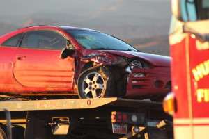 Red Mitsubishi Eclipse damaged in collision on West State Street, Hurricane, Utah, Dec. 24, 2015 | Photo by Cody Blowers, St. George News