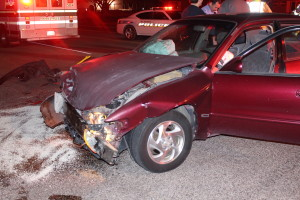 Maroon Toyota Corolla after two car collision in the intersection of 200 North and 300 West in St. George, Utah, Dec. 29, 2015   Photo by Cody Blowers, St. George News