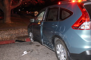 Extensive damage to vehicle on driver's side after impact in intersection of 200 North and 300 West in St. George, Utah, Dec. 29, 2015 | Photo by Cody Blowers, St. George News