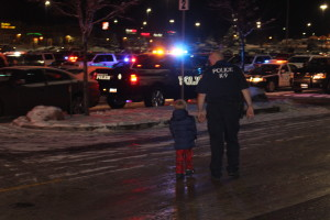 A child and a police officer walk to the car to drive to breakfast at the annual Shop with a Cop event, Cedar City, Utah, Dec. 12, 2015 | Photo by Emily Hammer, St. George News