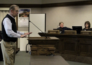 Southern Utah University Economics Professor Joe Baker introduces his class and their project to the audience in Council Chambers, Cedar City, Utah, Dec. 2, 2015 | Photo by Carin Miller, St. George News