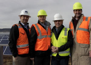 Left to right: Swinerton Renewable Energy Vice President George Hershman, Scatec Solar ASA EVP Power Production and Asset Management Torstein Bernsten, Scatec Solar North America Luigi Resta and Array Technologies President Thomas Conroy show off the solar fields at the new Utah Red Hills Renewable Park, Parowan, Utah, Dec. 10, 2015 | Photo taken by Carin Miller, St. George News