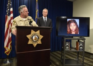 Clark County Sheriff Joe Lombardo, left, and Clark County District Attorney Steve Wolfson attend at a news conference. The two officials spoke about the car driven by suspect Lakeisha N. Holloway, pictured on monitor, of Oregon, who police said smashed into crowds of pedestrians on the Las Vegas Strip on Sunday night, killing one person and injuring dozens. Las Vegas, Nevada, Dec. 21, 2015 | AP Photo by David Becker, St. George News