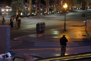 A crime scene analyst, right, takes photos as Las Vegas Metro Police and Nevada Highway Patrol troopers investigate an incident where police said a woman intentionally swerved her car into pedestrians on the Las Vegas Strip, killing one person and injuring at least 30 others. Las Vegas, Nevada, Dec. 20, 2015.   Photo by Steve Marcus, Las Vegas Sun via AP, St. George News
