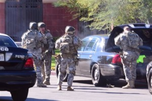 A swat team arrives at the scene of a shooting. Police responded to reports of an active shooter at a social services facility, San Bernardino, Calif., Dec. 2, 2015 | Photo courtesy of Doug Saunders/Los Angeles News Group via AP, St. George News