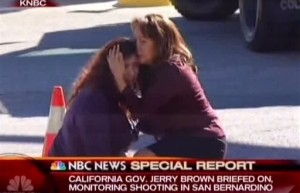 Two women comfort each other near the scene of a shooting outside a Southern California social services center, where one or more gunmen opened fire, shooting multiple people, San Bernardino, Calif., Dec. 2, 2015 | Photo courtesy of KNBC via AP, St. George News