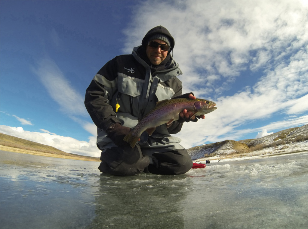 A fisherman shows off his catch, location unspecified, Feb. 1, 2014 | Photo by Ryan Mosley, Utah Division of Wildlife Resources, St. George News