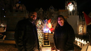 "Frank and Kim Kuhn standing standing by the trophy their ""Christmas Spectacular"" won on ABC's ""The Great Christmas Light Fight,"" St. George, Utah, Dec. 7, 2015 