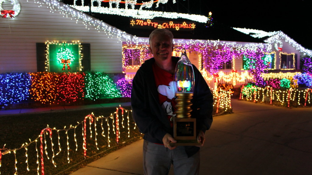 dan olsen stands in front of his home holding the trophy from abcs the christmas light fight olsens home is the second in st george to compete on the - How To Program Christmas Lights