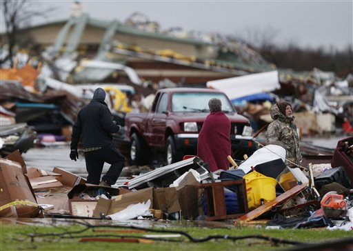 People assess the damage to a storage facility destroyed by Saturday's tornado in Garland, Texas, Dec. 27, 2015 | Photo by Nathan Hunsinger, The Dallas Morning News via AP, St. George News