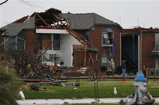 A man takes pictures of damage outside an apartment complex after Saturday's tornado, Garland, Texas, Sunday, Dec. 27, 2015 | Photo by Nathan Hunsinger, The Dallas Morning News via AP, St. George News