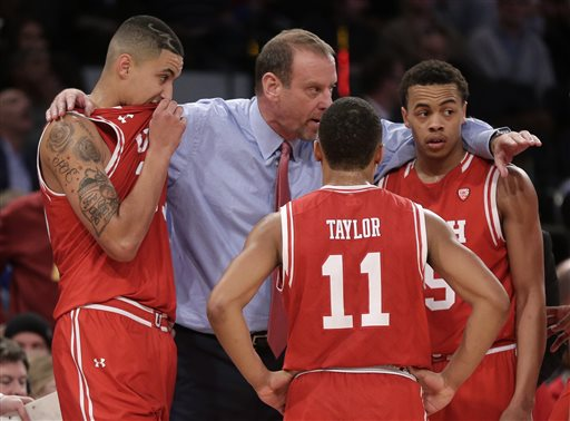 Utah head coach Larry Krystkowiak gathers his players during a timeout in overtime of an NCAA college basketball game against Duke, Saturday, Dec. 19, 2015, in New York. Utah won 77-75. (AP Photo/Julie Jacobson)